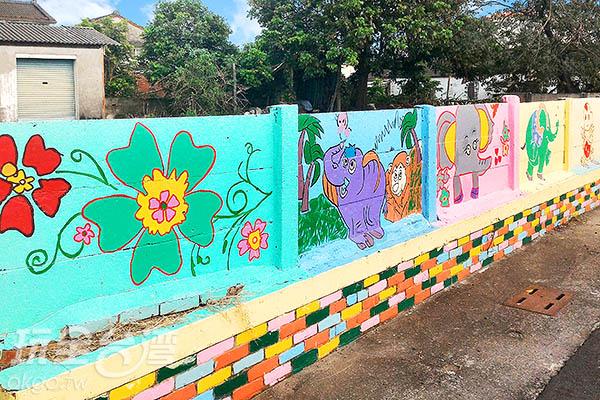 圍牆上隨處可見可愛的彩繪/玩全台灣旅遊網攝