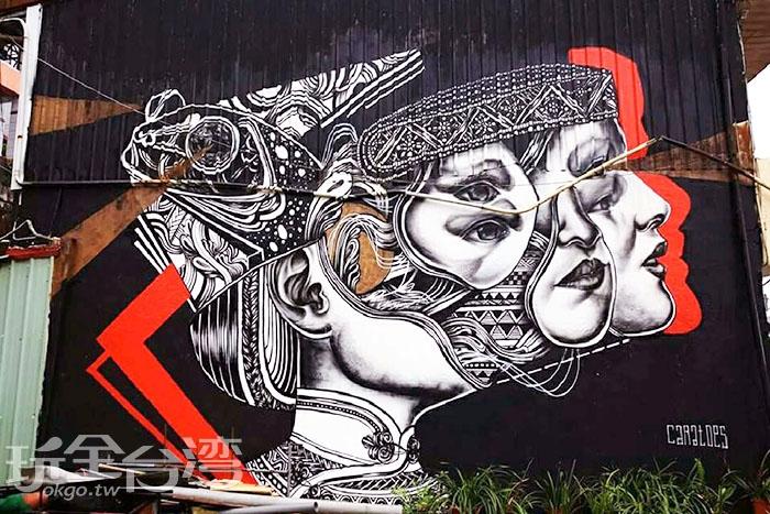 這幅塗鴉作品相當大膽前衛,比利時畫家用不同角度的臉龐打造出不同的視覺效果。/玩全台灣旅遊網特約記者攝