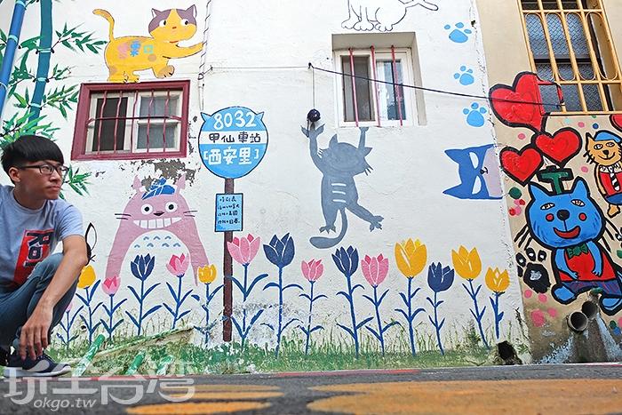 充滿貓咪塗鴉的可愛情景,有許多可以讓遊客互動拍照的創作巧思,例如跳繩、拔河、躲貓貓、拔河,拍起來好趣味/玩全台灣旅遊網特約記者阿辰攝