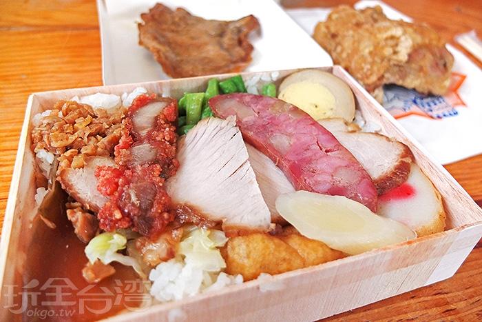 超有料的便當,配料有排骨、滷蛋、肉片、紅燒肉、青菜等等。/玩全台灣旅遊網特約記者阿辰攝