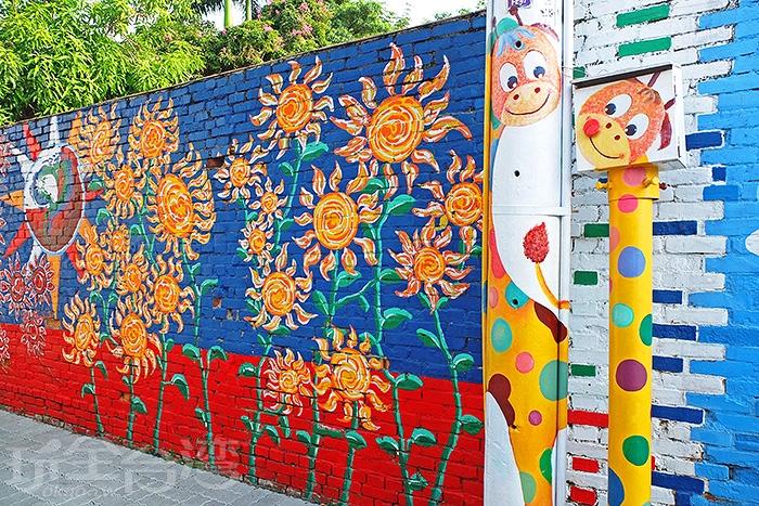 大面積老眷村活化藝術,重新賦予老眷村最甜美亮眼的趣味新氣象。/玩全台灣旅遊網特約記者阿辰攝