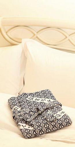 商務套房內提供舒適的睡袍,讓你一夜好眠
